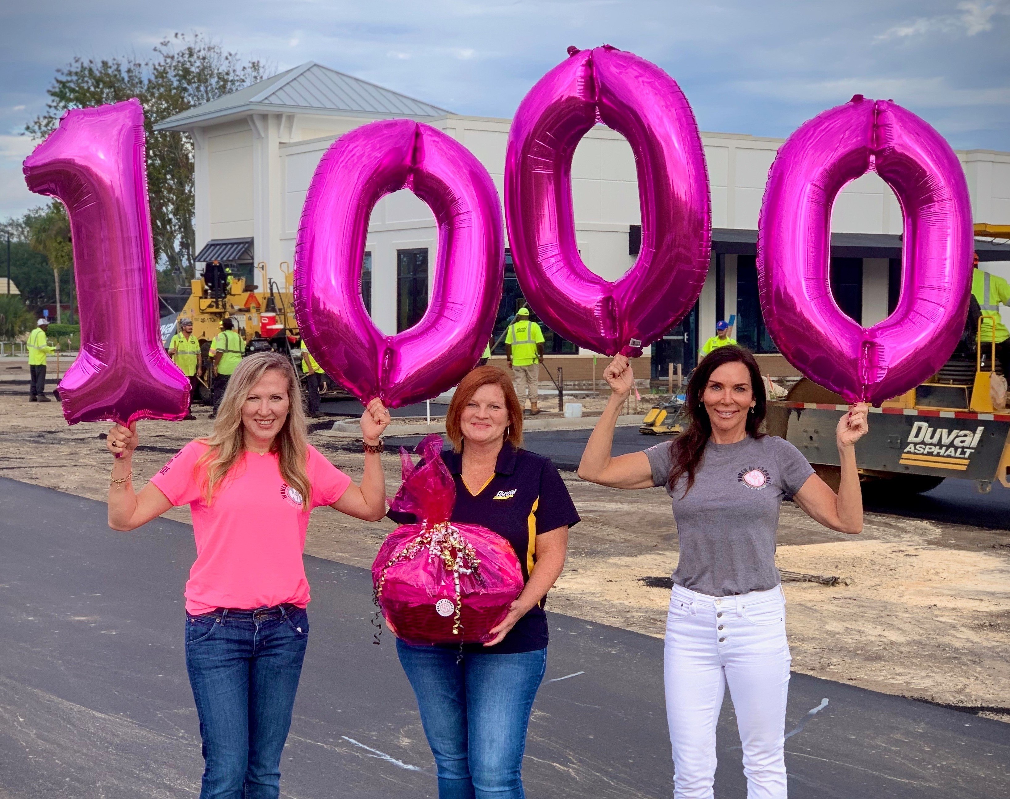 Amy Miller (L) and Natasha Ozybko (R) surprising WofA's 1,000th member Marsha Johnson (C) at her jobsite.